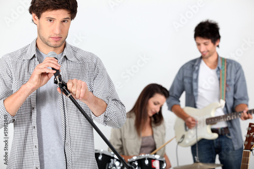 Three musicians rehearsing