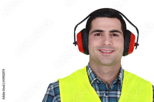 Construction worker in earmuffs