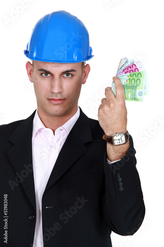 Young architect holding bank notes