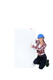 Brunette builder giving thumbs-up by blank poster