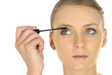 Blond applying mascara