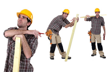 Builder with a piece of timber