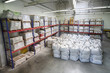 Small warehouse with lot of big white sacks