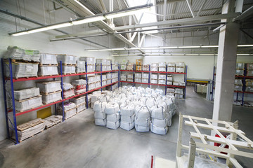 Warehouse with sacks at factory