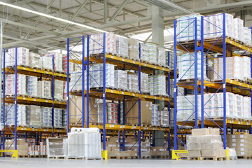 Large warehouse with lots of tall shelves with packed containers