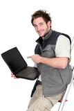 Tiler with a laptop showing a blank screen