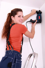 Woman drilling roof