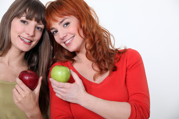 duo of girls with apples