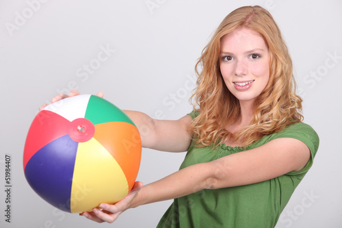 young woman with a beach ball
