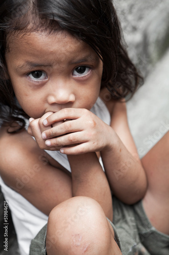 Asian child living in poverty