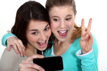 two girls taking picture of themselves
