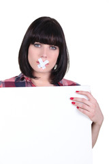 Talkative woman with her mouth sealed off