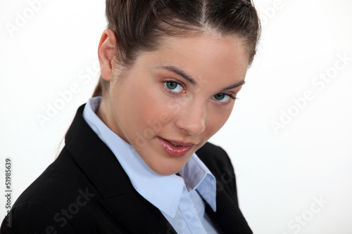 young woman in a suit posing