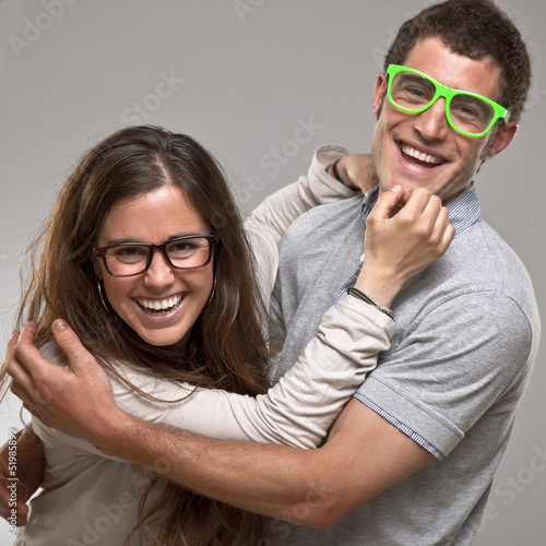 Portrait of a beautiful young happy smiling couple with glasses