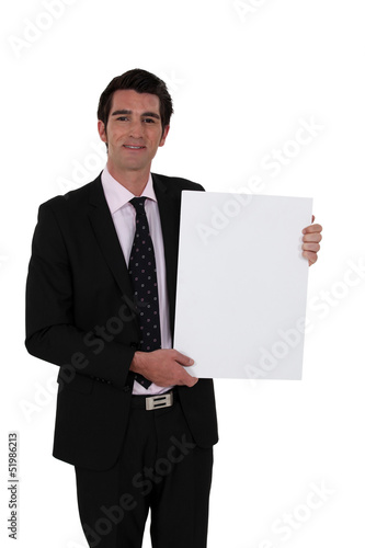 smart businessman making presentation against white background