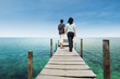 Couple walking on deck at paradise island