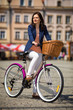 Urban biking - middle-age woman and bike in city