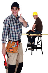 Two cheerful carpenters