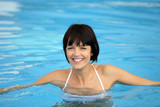 Cheerful woman in swimming pool
