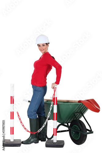 Road-side worker with wheelbarrow