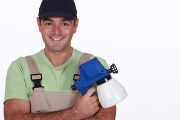 Man with a pressure sprayer