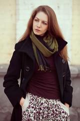 Beautiful girl in a fashionable coat