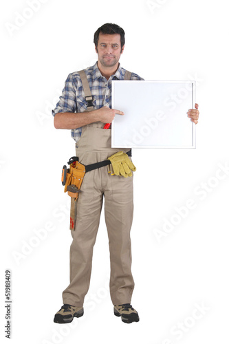 Handyman pointing to poster