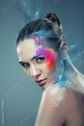 girl with coloured flying powder on face