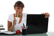 Business woman drinking at desk