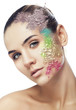 woman with cracked coloured powder on face