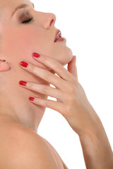 woman in profile with bare shoulders polished nails