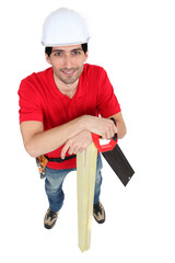 Smiling carpenter with a saw