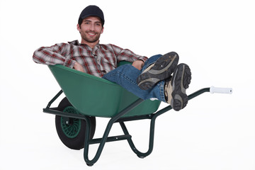 Man with a wheelbarrow.