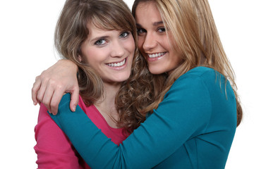 Two female friends hugging.
