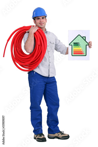 craftsman holding an energy consumption label