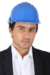 businessman wearing a helmet