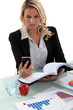Blond woman reading through important documents