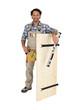 Carpenter stood with wooden door