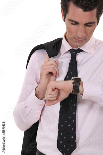 Businessman checking his watch for the time