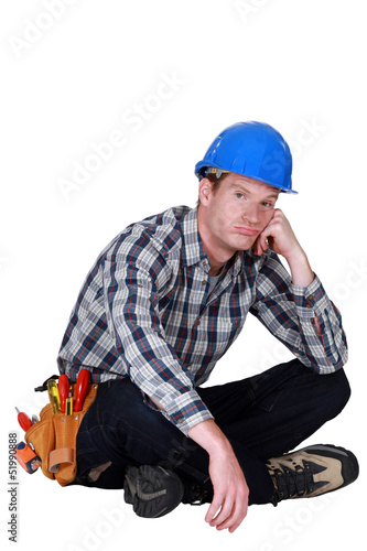 Bored builder sat on the floor