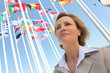 Businesswoman with flags.