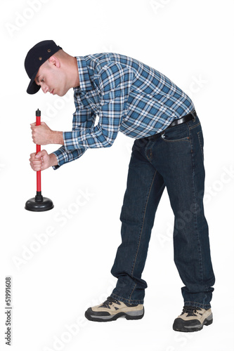 Plumber using plunger isolated on white background