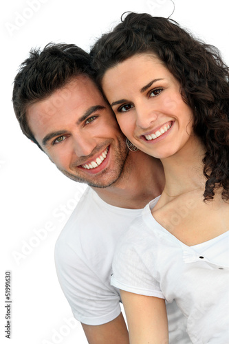 Cheerful couple in front of blue wall