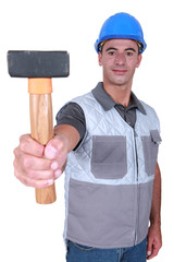 handyman showing hammer