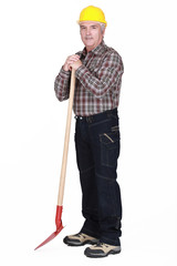 senior craftsman holding a shovel
