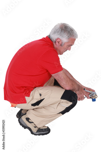 Man using pliers