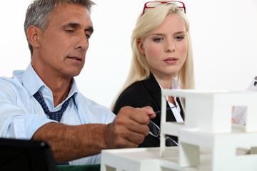 Architects examining a model
