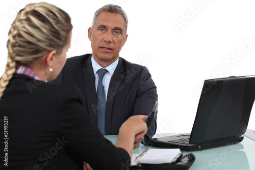 Two office workers in meeting