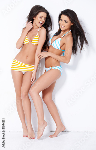 Happy ladies posing in swimsuits
