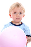 Young boy holding ball
